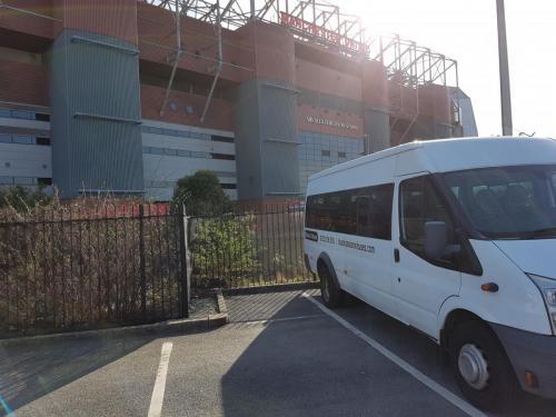 Minibus outside Old Trafford
